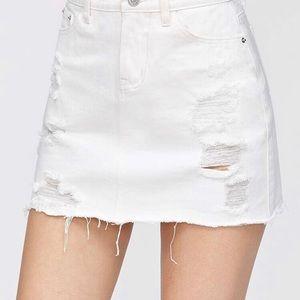 LOFT distressed jean mini skirt